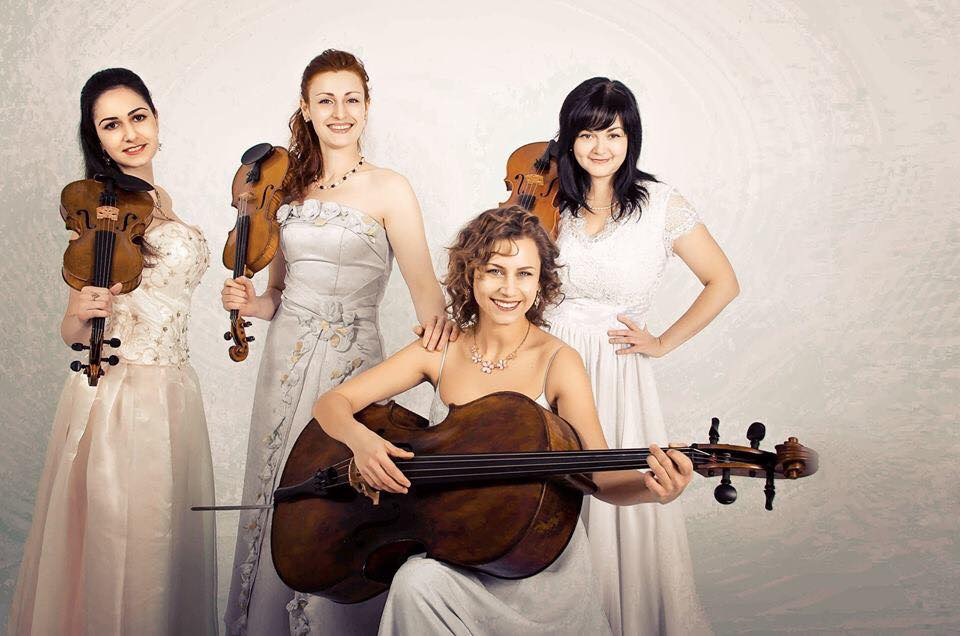 In White Dresses Holding Cello